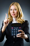 Businesswoman with calculator Royalty Free Stock Image