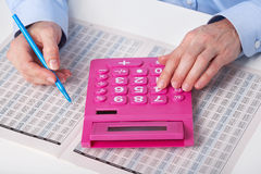 The businesswoman and calculator Stock Photos