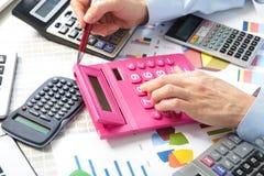 The businesswoman and calculators Stock Photo