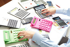 The businesswoman and calculators Stock Images