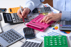 The businesswoman and calculators Royalty Free Stock Images