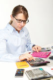 The businesswoman and calculators Royalty Free Stock Photo