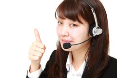 Businesswoman of call center with thumbs up gesture Royalty Free Stock Photos
