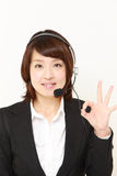 Businesswoman of call center  showing perfect sign Royalty Free Stock Image