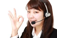 Businesswoman of call center showing perfect sign Stock Photos