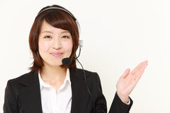 Businesswoman of call center showing something Royalty Free Stock Photos