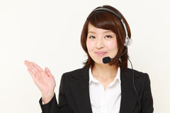Businesswoman of call center showing something Stock Images