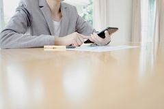 Businesswoman call mobile phone on her office Royalty Free Stock Photo