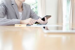 A Businesswoman call mobile phone on her office Royalty Free Stock Images