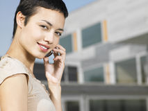 Businesswoman On Call Outside Office Royalty Free Stock Image