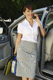 Businesswoman On Call While Standing By Car Stock Photo