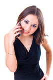 Businesswoman calling by cell phone. Over white Royalty Free Stock Photo