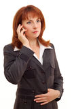 Businesswoman calling cellphone Royalty Free Stock Images
