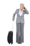Businesswoman calling and has luggage Stock Photo