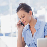 Businesswoman calling with her mobile phone Stock Photo