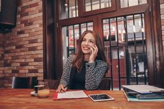 Businesswoman calling on mobile phone and taking notes stock photos