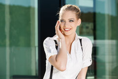 Businesswoman calling on the mobile phone Royalty Free Stock Images
