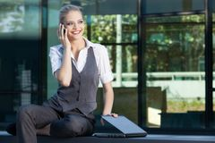 Businesswoman calling on the mobile phone Stock Image