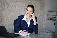 Businesswoman calling in office Royalty Free Stock Images