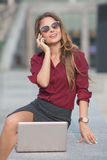 Businesswoman calling over the phone Stock Photos