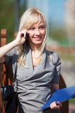 Young business woman calling on the phone. Young blond businesswoman calling on the cell phone Royalty Free Stock Images