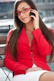 Businesswoman  calling by phone, looking at camera Royalty Free Stock Image