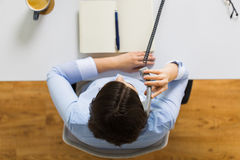 Businesswoman calling on phone at office table royalty free stock photos
