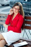 Businesswoman  calling by phone outdoors Stock Image