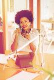 Businesswoman calling on smartphone at office Royalty Free Stock Photography