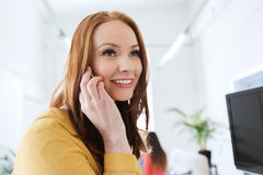 Businesswoman calling on smartphone at office Stock Images