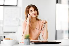 Businesswoman calling on smartphone at office stock photography