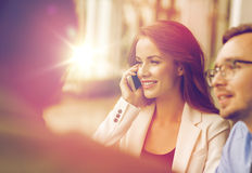 Businesswoman calling on smartphone at office Royalty Free Stock Photos