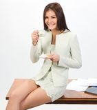 Businesswoman with cap of coffee Stock Image