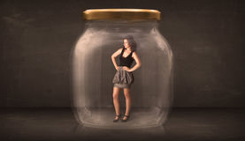 Businesswoman captured in a glass jar concept Royalty Free Stock Photos