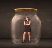 Businesswoman captured in a glass jar concept Royalty Free Stock Photography