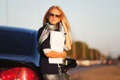 Business woman with financial papers at the car Stock Image