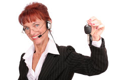 Businesswoman with a car key Royalty Free Stock Images