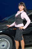 Businesswoman in car shop Stock Image