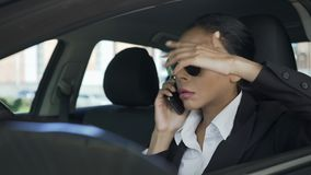 Businesswoman in car talking over mobile phone gesturing angrily, failed deal. Stock footage stock video