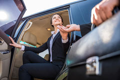 Businesswoman in the car Stock Images