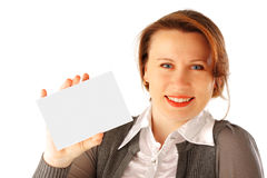 Businesswoman with Card. Young woman holding a blank card. She's smiling Stock Photography