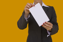 Businesswoman card 2. Businesswoman showing a blank card with a colored background (focus on the card Royalty Free Stock Photography
