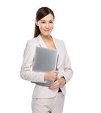 Businesswoman carry with laptop computer Royalty Free Stock Photo