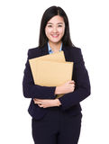 Businesswoman carry with many folder Royalty Free Stock Images