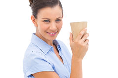 Businesswoman carrying coffee cup Royalty Free Stock Photos