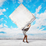 Businesswoman carrying cube Royalty Free Stock Photo