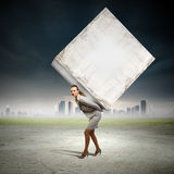 Businesswoman carrying cube Royalty Free Stock Photography