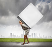 Businesswoman carrying cube Stock Image