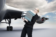 Businesswoman carrying folders Stock Photos