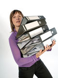 Businesswoman carrying folders Royalty Free Stock Photography